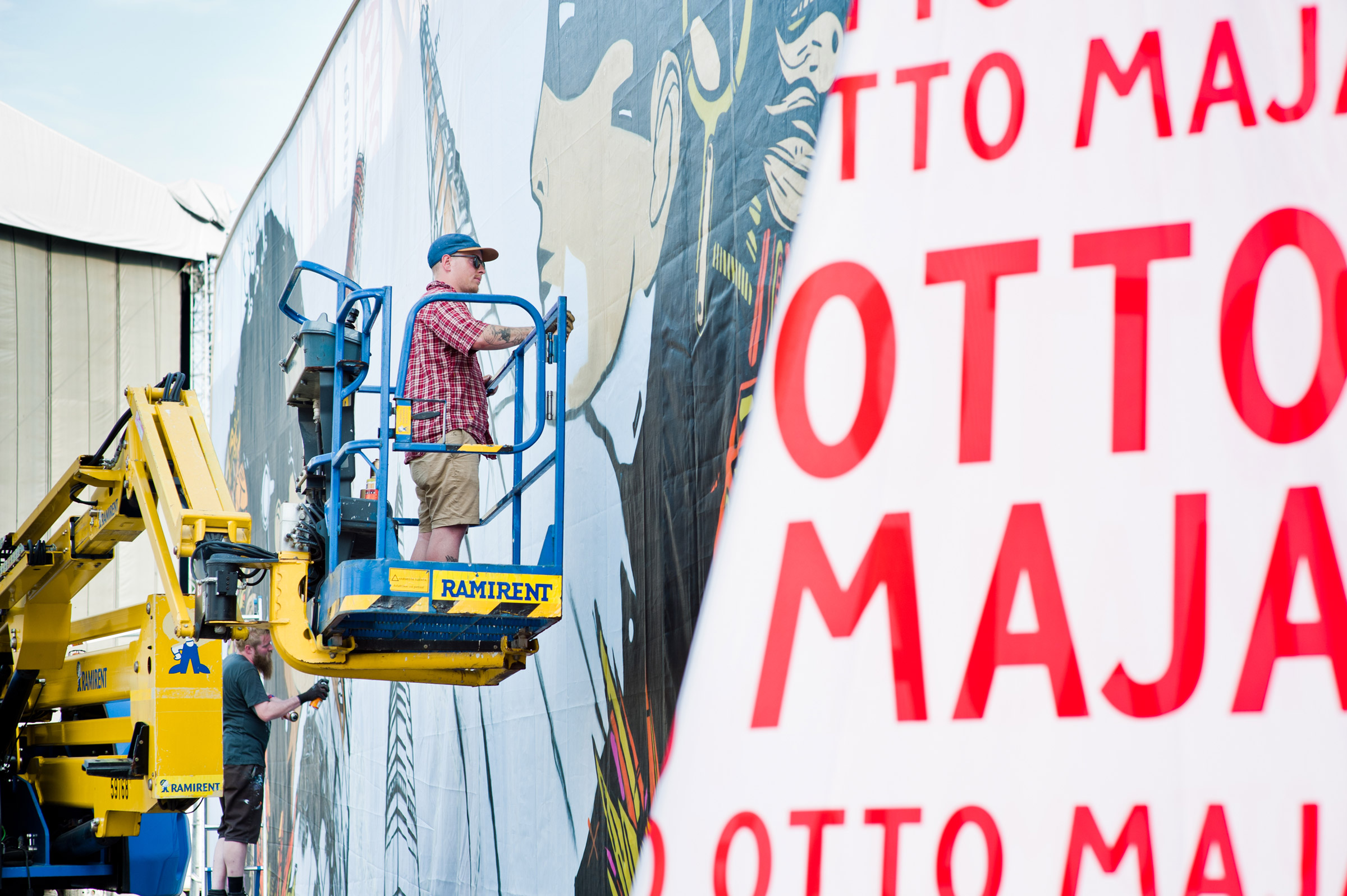 Otto Maja painting his art piece at Flow Festival 2013